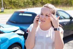 Female Driver Making Phone Call After Traffic Accident Stock Photos