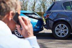 Driver Making Phone Call After Traffic Accident Stock Photos