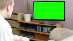 Man watches TV(television) - green screen - man expressed sadness - stock footage