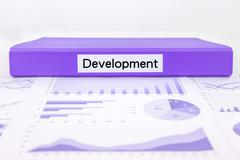 development report, graphs, charts of evaluation - stock photo