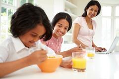 Children having breakfast with mother before school Kuvituskuvat