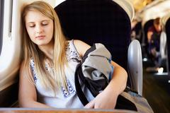 teenage girl resting on train journey - stock photo