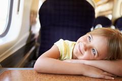 girl relaxing on train journey - stock photo