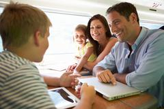 Family relaxing on train journey Stock Photos