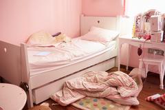 Empty and untidy child's bedroom Stock Photos
