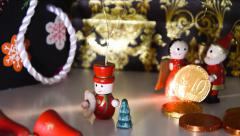 Christmas figure and euro coins, concept Stock Footage