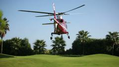 Helicopter landing  on the beautiful green pad. Sequence 3 shot Stock Footage
