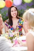 Female guest at wedding reception Stock Photos
