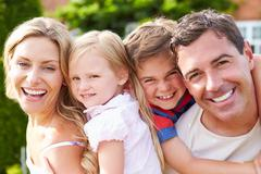 Portrait of happy family in garden Stock Photos