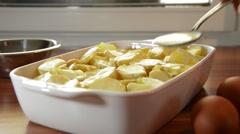 Preparing moussaka in a ceramic baking dish Stock Footage