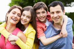 Portrait of hispanic family in countryside Stock Photos