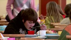 Pupils at the canteen during a school meals - stock footage