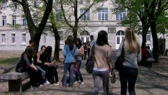 Students in the yard of the high school Stock Footage
