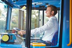 Portrait of bus driver behind wheel Stock Photos