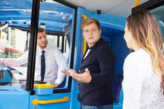 Passenger arguing with bus driver Stock Photos
