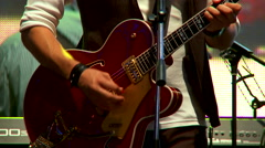 Musician playing guitar at the concert Stock Footage