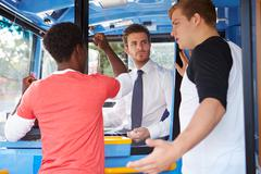 Passengers arguing with bus driver Stock Photos