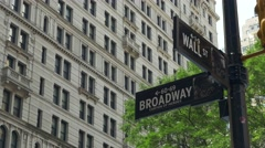 0549 UHD Wall Street and Broadway cross road in New York City Arkistovideo