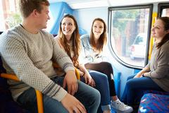 Group of young people on bus journey together Stock Photos