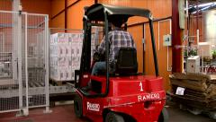 Worker loading packages of wine with forklift in the factory Stock Footage