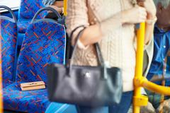 Passenger leaving change purse on seat of bus Stock Photos
