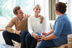 counselor advising couple on relationship difficulties - stock photo