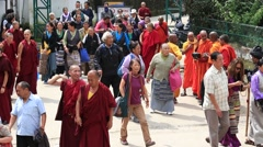 Tibetan monks and people from the lessons of the Dalai Lama, McLeod Ganj. India Stock Footage