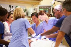 Medical team working on patient in emergency room Kuvituskuvat