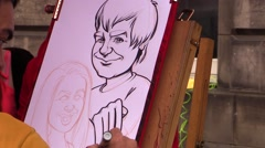 Street artist's drawing Stock Footage