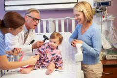 Mother and daughter in pediatric ward of hospital Stock Photos