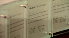 Stock Video Footage of Diplomas awarded by Microsoft for cooperate with their partners