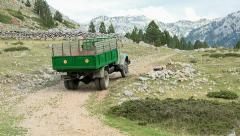 Old truck on a mountain dirt road Stock Footage