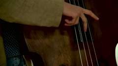 Musician playing double bass at the concert Stock Footage