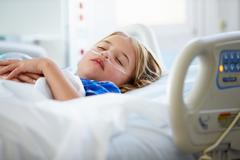 Young girl sleeping in intensive care unit Stock Photos