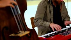 Musicians playing keyboards and double bass at the concert Stock Footage