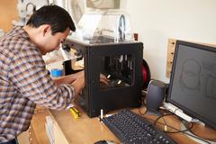 male architect using 3d printer in office - stock photo