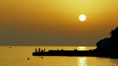 Beautiful sunset on the sea over the fortress Stock Footage