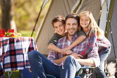 Father and children enjoying camping holiday in countryside Stock Photos
