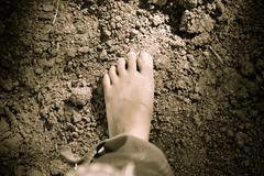 feet walking on soil - stock photo
