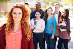 Portrait of university students outdoors on campus Kuvituskuvat