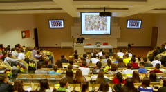 Students listen a lecture at the university - stock footage