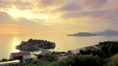 Peninsula and the city Sveti Stefan (St.Stephen) in the Adriatic Sea, Montenegro Stock Footage