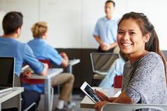 Female high school student digital tablet in classroom Stock Photos