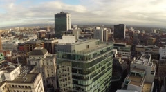 Manchester UK Aerial city landscape, passing over office building Stock Footage