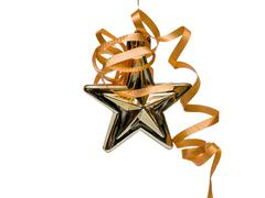 Gold christmas star with ribbon Stock Photos