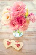 Love still life - beautiful eustoma flowers and two handmade hearts Stock Photos
