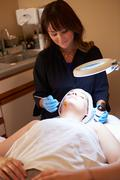 Woman having dermo abrasion cosmetic treatment at spa Stock Photos