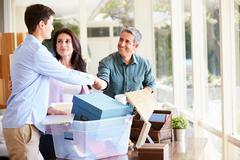 Parents helping teenage son pack for college Stock Photos