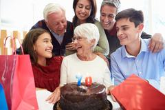 Family celebrating 70th birthday together Stock Photos