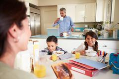 Hispanic family eating breakfast at home before school Kuvituskuvat